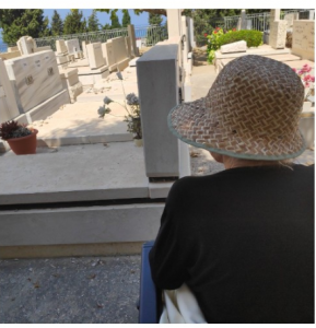 pr golden - 1 wish - Leah at husband's kever-facing grave-